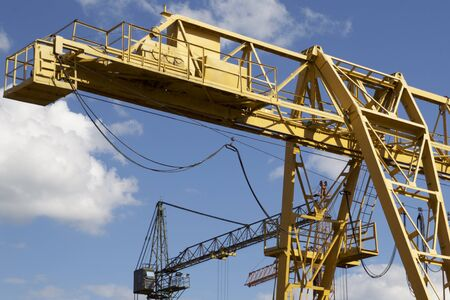 palate: Metal construction of the crane, against the sky, in the warehouse, Russia Stock Photo