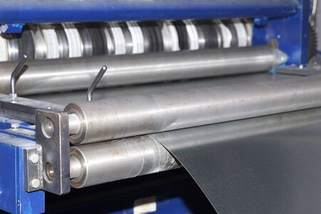 Process of cutting a wide sheet of metal into narrow strips on a machine, Russia