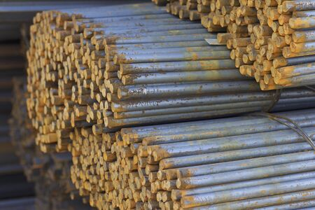 Metal profile of round section in packs at the warehouse of metal products, Russia