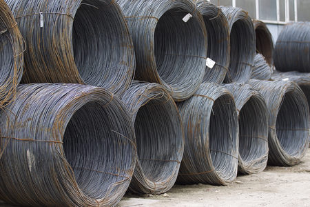 Thin metal reinforcement wound into bays at the metal products warehouse, Russia Stock Photo