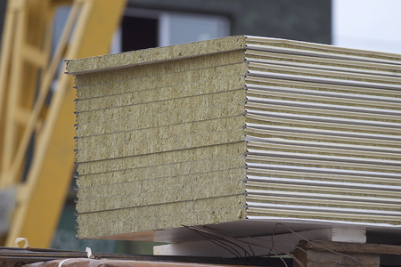 Wall panels with a heater in a pack in a warehouse, Russia