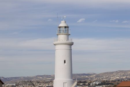 Lighthouse in the background of the sky in the town of Paphos, Cyprus