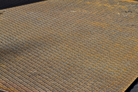 Corrugated ferrous sheet with corrosion elements