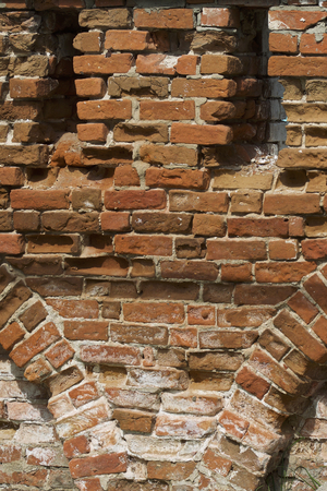 Fragment of ancient brickwork walls of the fencing of the monastery