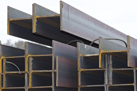 Metal profile beam in packs at the warehouse of metal products, Russia