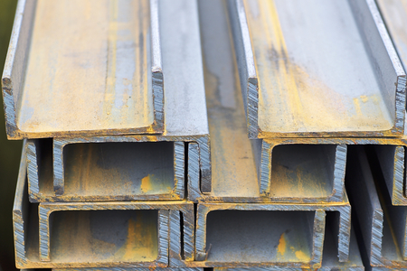 Metal profile channel in packs at the warehouse of metal products, Russia