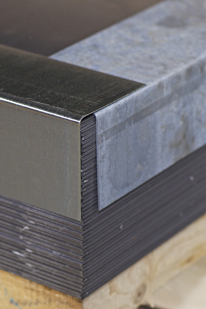 Galvanized sheet in packs in metal products warehouse, Russia