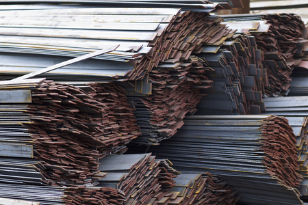 Metal profile strip in packs at the warehouse of metal products, Russia Фото со стока