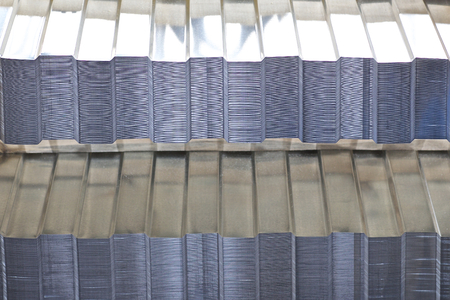 Profiled galvanized sheet with polymer coating in packs in the warehouse of metal products, Russia