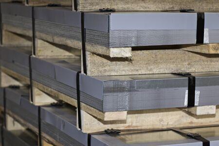 Sheet metal is in bundles in the warehouse, Russia