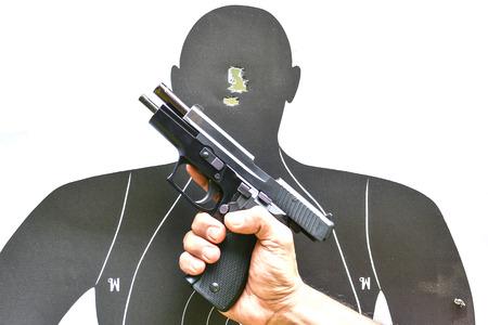 airgun: Paper target and pistol Stock Photo