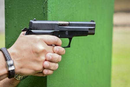 marksmanship: people aiming gun
