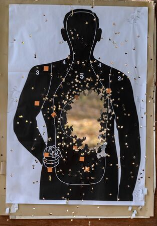 Targets for shooting shaped like a human with bullet holes in body and a head shot. Concept sport practice training Stockfoto