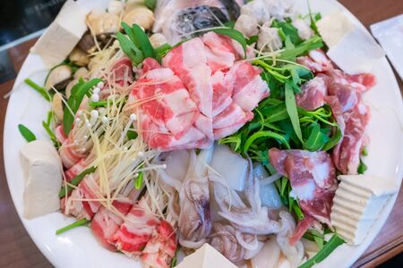 Set of hot pot with vegetables morning glory, mushroom, bacon, seafood shrimp, squid, shellfish, fish, ball, tofu delicious Asian cuisine Vietnamese traditional food