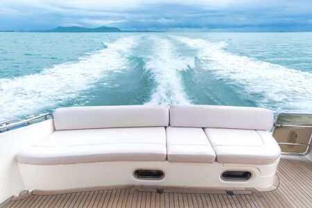 White sofa set on a luxury yacht stern interior comfortable design for holiday recreation tourism travel and vacation concept Imagens