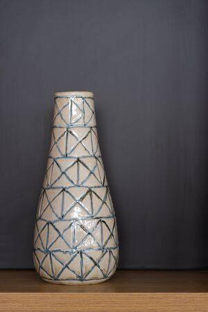 Beautiful ceramic terracotta vase on wooden cabinet interior modern office building or home and living decoration contemporary