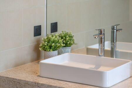 Modern faucet and white ceramic washbasin sink bathroom interior building decoration, concept bathroom toilet contemporary