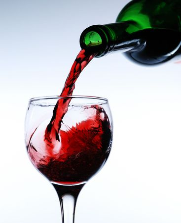 Red wine pour in a glass photo
