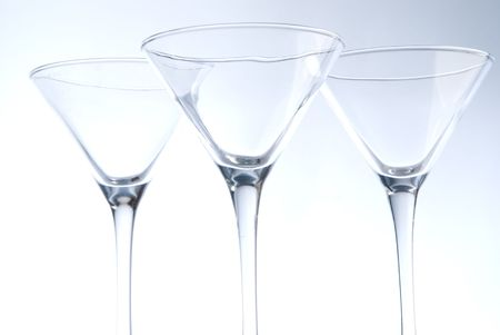 solemnize: three coctail glasses on light background