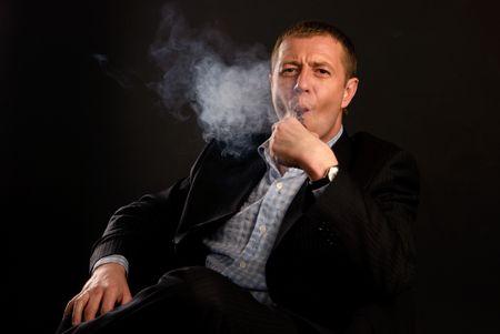 man in suit smoking tobacco-pipe photo