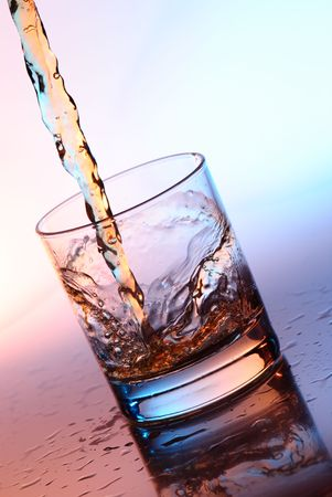 thirsting: The stream filling an empty glass by alcohol