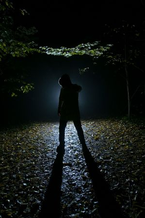 Siluette of man in the forest on the night Stock Photo