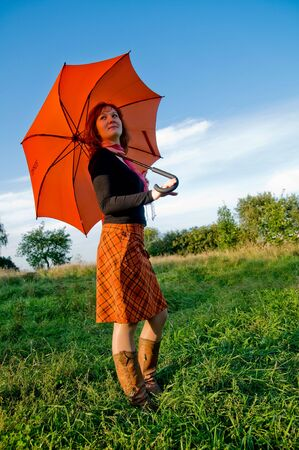 Young girl with orange umbrella photo