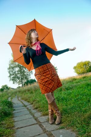 Girl with umbrella photo