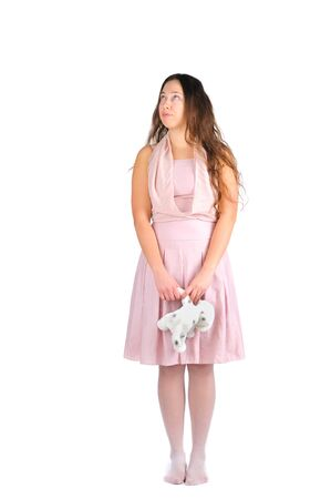 disenchantment: Girl with favorite toy over white background Stock Photo