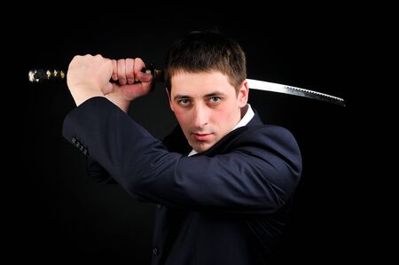 Young man hold sword photo