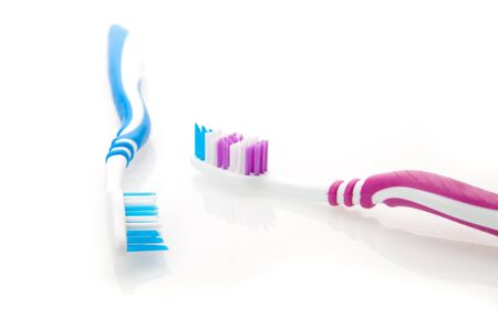 two color toothbrushes photo