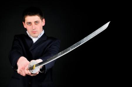 katana: Jonge man houd zwaard
