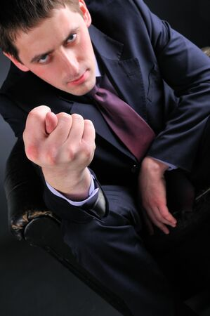 young men with fig, focus on fingers photo