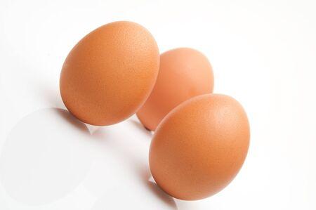 Some eggs on white background photo