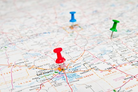 Color pushpins marking a location on a road map. photo