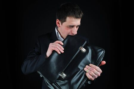 avid: young man eating suitcase