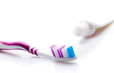 color toothbrush and toothpaste photo