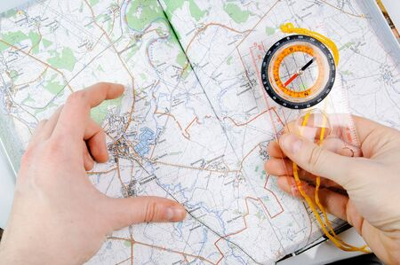 multiplying: Concept with map, compass and human hands Stock Photo