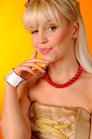 Portrait of pretty woman on orange background photo