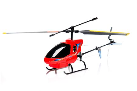 Toy helicopter over white background photo