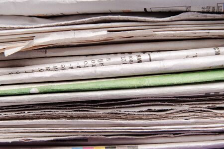 reading material: Stack of newspapers Stock Photo