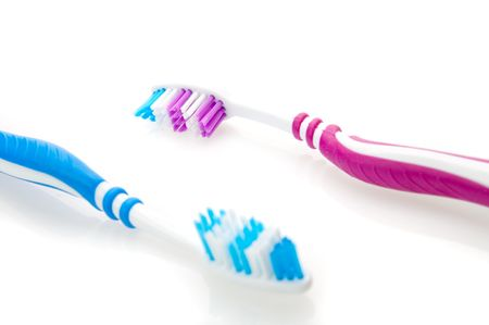reb: two color toothbrushes. Focused on reb toothbrush