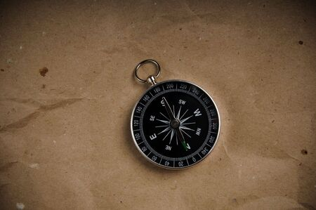 imagery: Compass over old grunge paper
