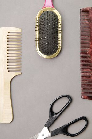 crewcut: Some barbers accessories over gray background