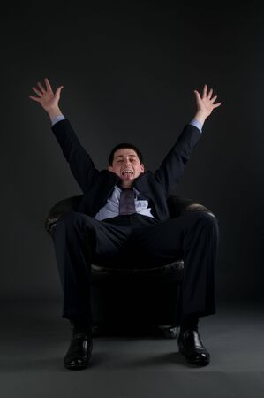 freetime: Young  businessman over gray background showing freedom