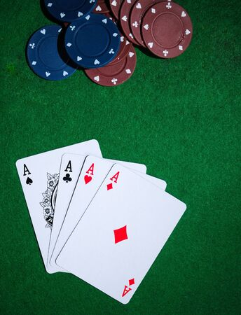 Background with four aces, playng cards and poker chips.