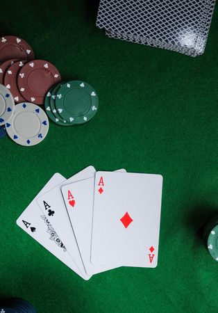 Background with four aces, playng cards and poker chips. photo