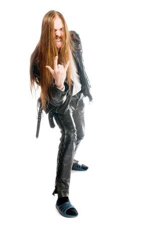 rock hand: simbolo di un gesto l'uomo di metalli pesanti con le pantofole a casa Archivio Fotografico