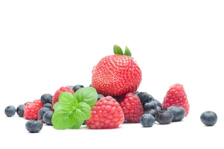 Isolated fresh berries with mint photo