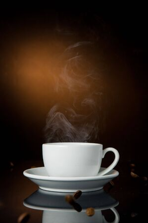 cappuccino: cup of coffe on color background Stock Photo